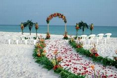 The only problem with a beach wedding is the wind and sand lol, but look how pretty