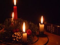Advent candles and a Bible.