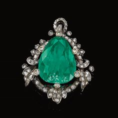 EMERALD AND DIAMOND PENDANT, LATE 19TH CENTURY  Set at the centre with a pear-shaped emerald, within a foliate border highlighted with rose diamonds, later pendant fitting.