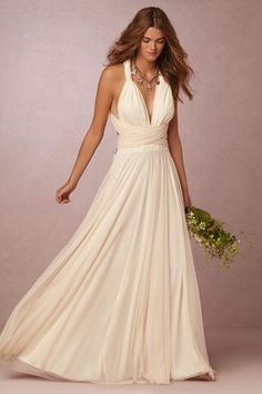 Style BHLDN GINGER CONVERTIBLE MAXI DRESS  The bridal version of one of our most popular bridesmaid dresses, this piece boasts over fifteen ways to wear—from strapless to halter to criss-crossed. Impossibly versatile, this NYC-made dress is an instant-hit with brides looking for a laidback yet sophisticated look, featuring the comfort of jersey, and the elegant look of a floor-skimming gown. Complementary for every body type, we love how the tulle overlay adds a bit of extra romance.For…