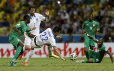 Greece's Andreas Samaris, center, is tackled by Ivory Coast's Kolo Toure, left, during the group C World Cup soccer match between Greece and Ivory Coast at the Arena Castelao in Fortaleza, Brazil, Tuesday, June 24, 2014. (AP Photo/Natacha Pisarenko) ▼24Jun2014AP|Greece scores late to advance at World Cup http://bigstory.ap.org/article/drogba-starts-ivory-coast-against-greece #Greece_Ivory_Coast_group_C #Brazil2014