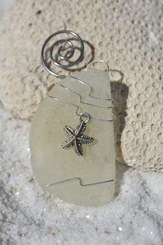 Genuine frosted sea glass Christmas ornaments with silver starfish charm. Genuine thick frosted white sea glass ornament. Dress up your Christmas tree and bring memories of warm summer nights and beach walks with this lovely sea glass Christmas ornaments.  The sea glass is real frosted beach glass that was collected on the sandy shores and rocky beaches of Casco Bay, in Coastal Maine. The beach sea glass was carefully selected for both its unique shape, thickness and its color. Each ornament…