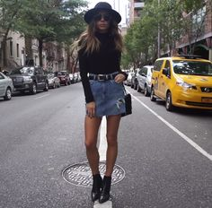 Black turtle neck + black boots + denim skirt+ hat