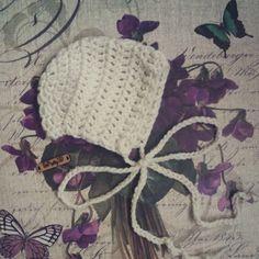Crocheted newborn bonnet