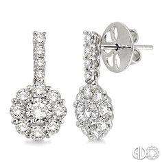 Flower cluster diamond earrings in 14k white gold. 1.5 total carat wt.