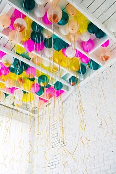 helium balloons in ceiling with tassels in theme colours