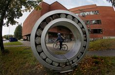 A Cyclist Rides Past The Aalto University School Of Science And Technology ...