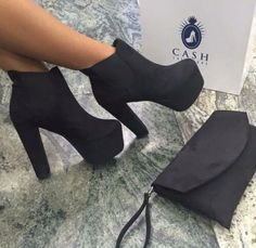 suede heeled booties, with a matching wristlet.