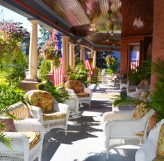 The sunny and welcoming grand porch at Union Gables in Saratoga Springs NY. Summer 2013. The historic Victorian mansion was built in 1901.