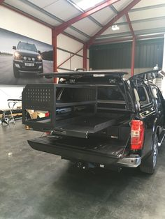 Nissan Navara fitted Twin Drawer, Infill Pods, Tailgate Gap Flap, Gearslide top, racking and our Gull Wing hardtop. Ute Camping, Camping Canopy, Truck Camping, Vw T3 Syncro, Volkswagen Transporter, Custom Truck Beds, Custom Trucks, Nissan Navara D40, Pickup Truck Accessories