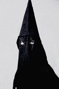 """News Bulletin:  """"In support of Black Heritage Month the Klan will wear Black outfits during the entire period."""""""
