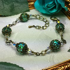 Rich Peacock Green Cathedral Crystal Wrapped in Antiqued Bronze Filigree Victorian Bracelet Resin Jewelry, Jewelry Crafts, Gemstone Jewelry, Beaded Jewelry, Filigree Jewelry, Jewlery, Victorian Jewelry, Antique Jewelry, Vintage Jewelry