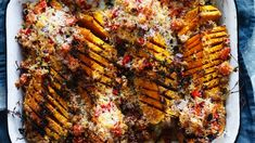 Hasselback pumpkin with cous cous and parmesan crust