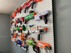 The Best Way to Organize Nerf Guns - Tidy Little Tribe Nerf Gun Storage, Toy Storage Shelves, Wall Storage, Nerf Gun Accessories, Nerf Mod, Clutter Organization, Boy Room, Organize, Guns
