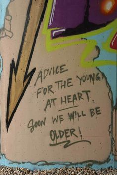 """Photo of the quote """"advice for the young at heart. soon we will be older!"""" written by a graffiti artist. #GetSome """"all day… every day"""""""