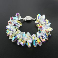 """Add tons of color and sparkle to your look with this bold Swarovski® crystal bracelet. Choose the perfect length. Shown 7 ½"""" long. Made with aurora borealis Swarovski crystals Crystal inlaid clasp (non-tarnishing) Handmade in USA Swarovski Bracelet, Swarovski Jewelry, Crystal Bracelets, Beaded Jewelry, Swarovski Crystals, Jewelry Bracelets, Unique Jewelry, Silver Jewelry, Necklaces"""
