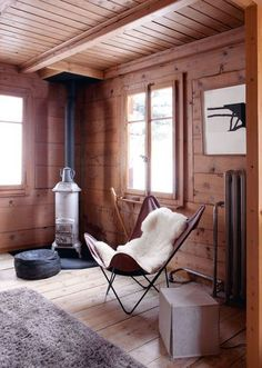 wood burning stove, butterfly chair #scandinavian #lounge - Loved by @denmarkhouse