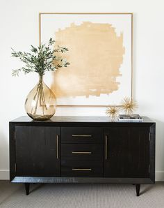 Chic bedroom features a gold abstract art placed over a black credenza adorned w. - Chic bedroom features a gold abstract art placed over a black credenza adorned with brass pulls top - Credenza Decor, Credenza Buffet, White Credenza, Sideboard Ideas, Black Sideboard, Modern Credenza, Home Design, Interior Design, Luxury Interior