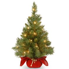 This Majestic Fir Christmas Tree with Battery-Operated Warm White LED Lights from National Tree Company would make a festive Yuletide holiday decoration accent. Features a red cloth base with gold rope tie and a convenient on/off automatic light timer. Pre Lit Christmas Tree, Christmas Light Displays, Christmas Lights, Christmas Decorations, Holiday Decorating, Christmas Store, Country Christmas, Merry Christmas, Decorating Ideas