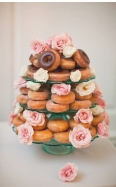 Doughnut cake! I love this. Stack cake stands then put doughnuts on them!