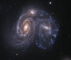 Arp 272 : Merging Galaxies - At image left, PGC 57058 (NGC 6050) and PGC 57053 (IC 1179) are in the process of merging.The small galaxy above the two (PGC 4019986), is thought to be either originally a satellite galaxy or possibly a result of the gravitational interaction, is now more thought to be a part of the merger. This merger is about 450 million light-years away in the constellation Hercules, a part of the Hercules Cluster, which is a part of the Great Wall