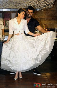With Arjun Kapoor, Kareena Kapoor Khan promotes her upcoming Film Ki and Ka in ankle-length sheer Skirt with beautiful botanical print and tie-up white crop top. Indian Gowns Dresses, Indian Fashion Dresses, Dress Indian Style, Indian Designer Outfits, Skirt Fashion, Indian Wedding Outfits, Indian Outfits, Designer Party Wear Dresses, Lehenga Designs