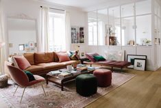 Morgane Sezalory's Dreamy Paris Apartment | What's not to love? That mirror! The wall structure! Comfy seating!