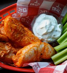 These tangy, spicy chicken tenders dipped in creamy blue cheese sauce are delicious enough to make you forget they're only 158 calories per serving. #chicken #dinner #dips #lunch #protein #recipes #snacks #BigGame