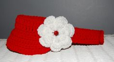 Red Visor with a lady bug in the flower.