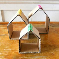 Super simple cardboard houses - could be used as doll houses for pretend play...