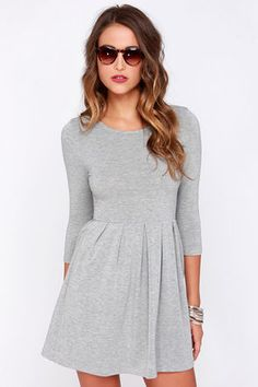 Go out this weekend and make a happy memory in the Keen About You Heather Grey Skater Dress ... with looks this good, how could you not?! A fitted jersey knit bodice and round collar make a perfect centerpiece between two fitted half sleeves, while an elastic waist gives way to a box-pleated skater skirt with light gatherings on back. Unlined. 48% Polyester, 48% Rayon, 4% Spandex. Hand Wash Cold or Dry Clean. Made with Love in the U.S.A.