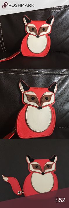 """Blaze a trail Fox coin purse 🦊 I'm selling a Kate Spade """"blaze a trail"""" coin purse. I purchased this and although I love it, realized it's not practical for me. It's been used a few times. There are three small ink stains on the front as shown in picture #3. It's a beautiful coin purse to add to any collection. The price is FIRM. Please ask any questions before purchase or for additional pictures! kate spade Bags"""