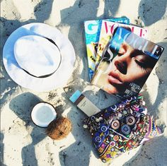 Beach tote musts: Magazines, hat, and a smartly packed beauty bag. #travel #whitesands #whattopack