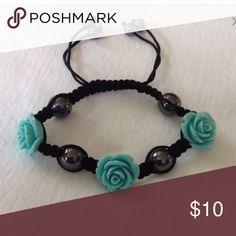 Pull string adjustable bracelet with rose accent Pull string adjustable bracelet with rose accent Jewelry Bracelets