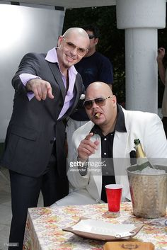 Hip-hop artists Pitbull (L) and Fat Joe are seen during the filming of Pitbull's new music video 'Secret Admirer' on October 20, 2007 in Miami Beach, Florida.