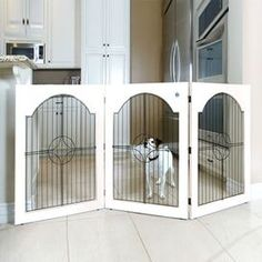 Here's an idea-Folding wood pet gate with metal openwork detail. Dimensions: 36 H x 53-69 W