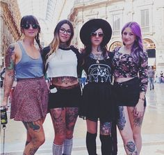 Pretty much everything going on in this photo is on point // crop tops, tattoos, high-waisted short shorts, floral print, skirts, tank tops, black, knee highs, big glasses, big hats, gold necklaces, Suicide Girls. Go Go / Zombie wins for sure.