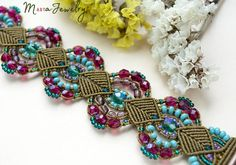 ✿ This is a micro-macrame bracelet. ✿ I used bronze, raspberry, turquoise, purple, teal colors. ✿ Quality materials used. ✿ The original design. ✿ Measurements: For a wrist approx. 17 cm / 6.7 inches. Width - 3.7 cm / 1.5 inches. ✿ Materials used: - Czech beads, - the nylon cord (durable), - findings. Actual colors may vary from the color on your screen due to monitor color restrictions. Victorian style bracelet, micro macrame jewelry, raspberry turquoise bronze, beaded lace, be...