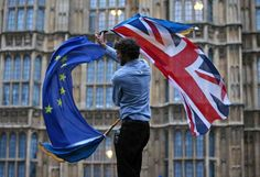 Islamic State applauds the British: 'Brexit threatens the unity of Crusader Europe'  A man waves both a British flag and a European Union flag outside Parliament at an anti-Brexit protest in London on Tuesday.
