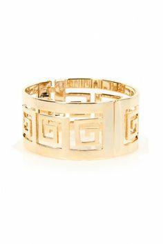 LoveMelrose.com From Harry & Molly | Givenchy Cuff bracelet - Gold  r #tops #croptops #aztec #lovemelrose #leggings #dress #shorts #highwaisted #highwaistedjeans #jeans #shoes #jewelry #hat #plus #plussize #earrings