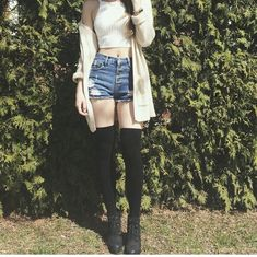 High waisted shorts, knee highs, and crop top