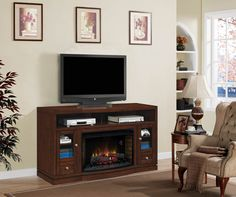 "The Wesleyan Deluxe is a contemporary, multi-function media cabinet with a solid wood base that features a partitioned center shelf. Two side cabinets with glass doors surround a 32"" ClassicFlame Electric Fireplace Insert."