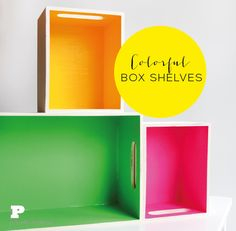 DIY colorful painted box shelves.  I love the bright paint on the inside of these plain wooden crates.