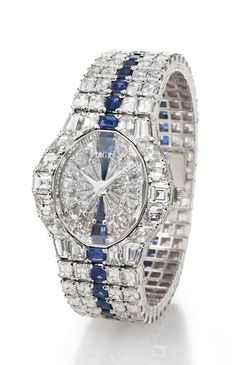 Piaget. A Large, Superlative and Extremely Rare 18K White Gold, Diamond and Sapphire-Set Bracelet Watch.