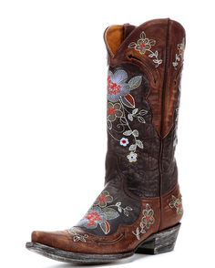 Embrace your whimsy with Old Gringo's Bonnie Boot - Vesuvio Brass. This masterpiece is handcrafted from supple chocolate and antique brown leather. Beautiful multi-colored flower embroidery accents both the shaft and foot, while arrow cutouts decorate the collar and foot. Yet another stunning creation by Old Gringo!<br><p></p><div>Old Gringo boots run true to size, we suggest buying the same size as your shoe size. If you are in between sizes, go with the smaller size. The leather will ...