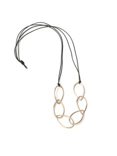 """This easy to wear necklace is sure to become your new go-to necklace. - Bronze links and leather cord. - Approximately 36 long. (But can be tied shorter!) - Each link is approximately 1 1/4"""" long. Com"""