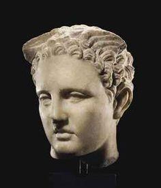 A ROMAN MARBLE HEAD OF MERCURY                                                                                                                                                                       CIRCA 1ST CENTURY B.C.-1ST CENTURY A.D.