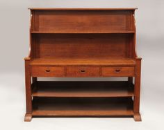 Lot 26 George Walton, Glasgow School: Arts and Crafts English Oak Sideboard With superstructure and recessed copper handles. 5 ft. 9 in. x 5 ft. 11 in. x 23 1/2 in.   Stair Galleries April 18 auction