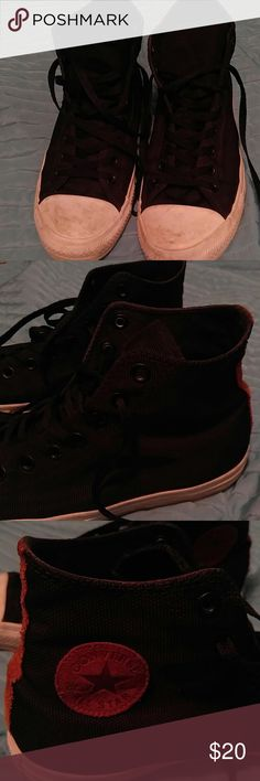Converse Chuck Taylor black canvas shoes Sz 10 Classic Converse All Star Chuck Taylor shoes. These are black canvas sneakers with white trim and brown faux suede logo and back. The white trim is dirty from wear but I've always preferred my Chucks with a broken-in look. Converse Shoes Sneakers