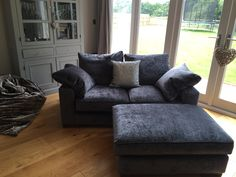 Made in the UK - fine examples of why it is so important to keep the traditional crafts alive by buying British! This Freycinet sofa and matching footstool are covered in Ross Fabrics Pistache slub velvet.